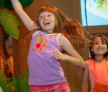 girl dancing at vacation bible school